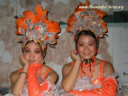 Two Thai dancers waiting for the show to start.